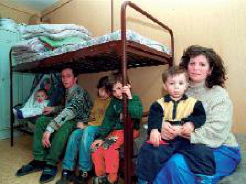 Familienleben in einer Gemeinschaftsunterkunft für Flüchtlinge in Sachsen Foto: ddp