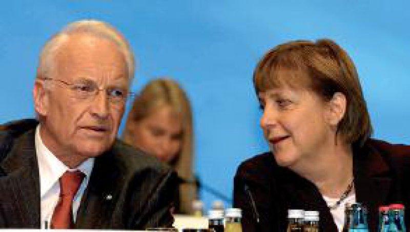 CDU-Chefin Angela Merkel muss beim CSU-Vorsitzenden Edmund Stoiber für ihre Reformpläne Überzeugungsarbeit leisten. Foto: ddp
