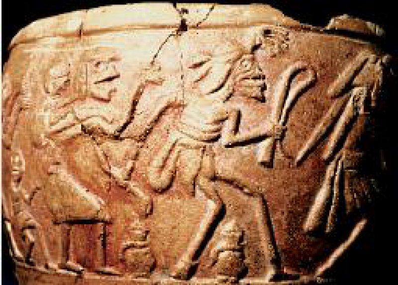 Jenseitsszene: Teilentfleischte Menschen im Reigen. In der Mitte ein Prothesenträger (Moche-Keramik, Ethnologisches Museum Berlin)
