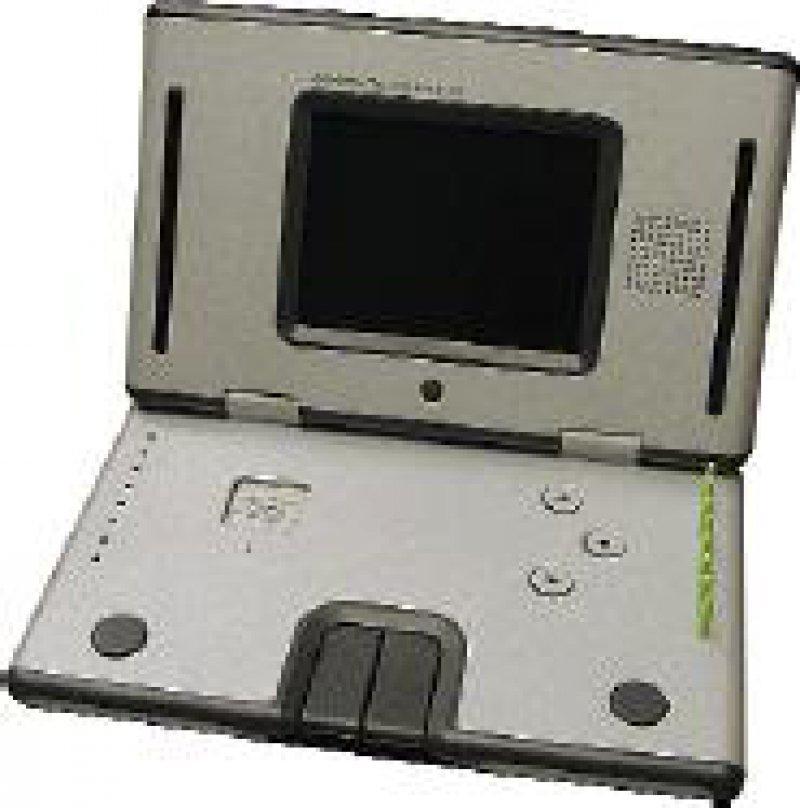 Wie ein Laptop mutet das Gerät an, mit dem sich verschiedene Parkinson- Symptome genau testen lassen: Testbatterie mit Display und Bedienelementen. Pegboard: acht Stifte (grün) rechts, Ziellöcher links