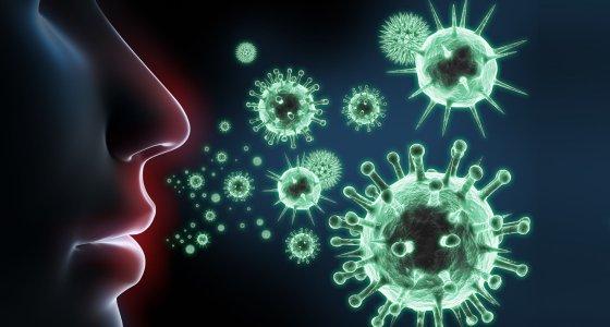 Diverse Viren in 3D-Ansicht vor einem Gesicht /peterschreiber.media, stock.adobe.com
